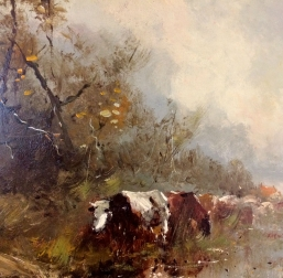Cows Grazing on a Riverbank